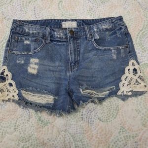 Free People distressed lace jean shorts